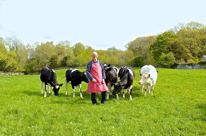 Farmer standing in field with his cattle