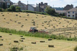 Farmer on tractor hay-baling